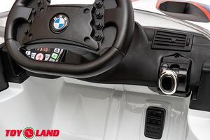 Детский автомобиль Toyland BMW М6 GT 3 белый
